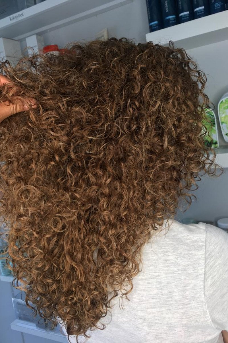 Sunkissed for defined popping curls